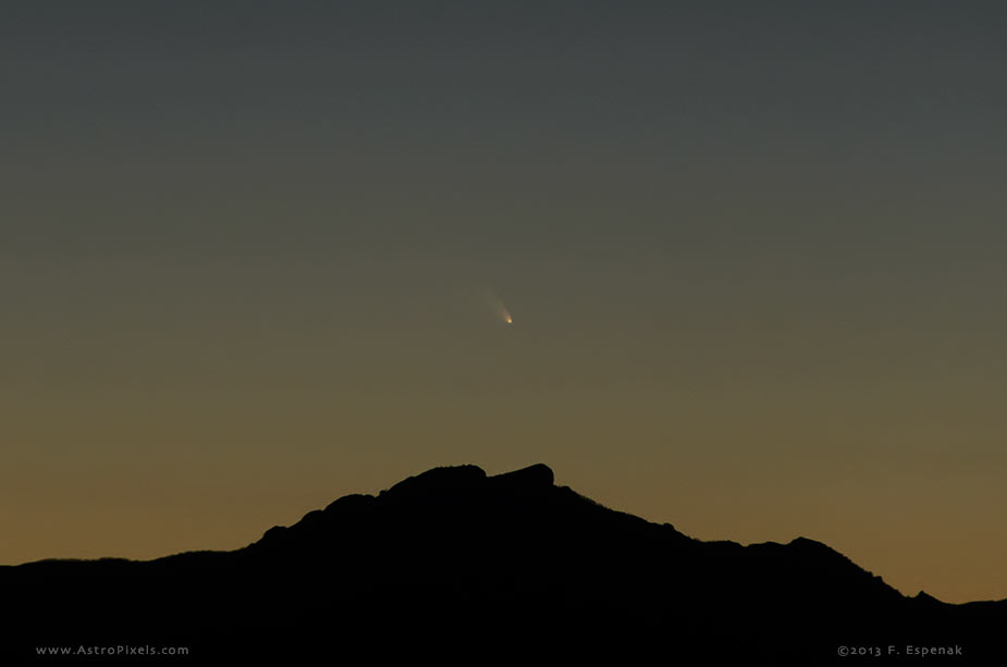 Comet Panstarrs first shows itself in bright twilight about 45 minutes after sunset on March 10. This image was captured from Granite Gap, NM using a Nikon D7000 and a Nikkor 18-200 VR lens. Photo copyright 2013 by Fred Espenak