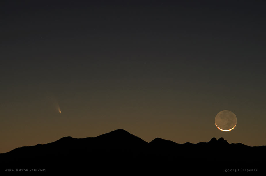 Comet PanSTARRS and the crescent Moon appear above the Dos Cabezas Mountains, Arizona shortly before setting. Photo copyright 2013 by Fred Espenak